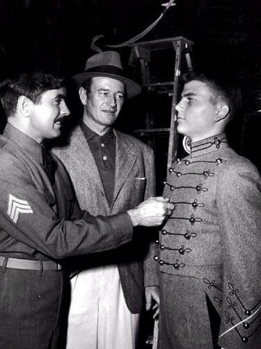 "John Wayne visits his son Patrick and Tyrone Power on the set of ""The Long Gray Line"" What a proud look on John Wayne's face as he looks at his son."