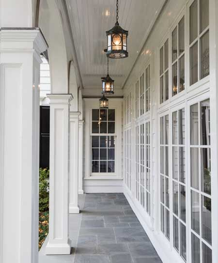 Beautiful porch / veranda. Love the grey tiles in a roman pattern.