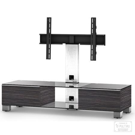 Sonorous MD 8140-C-INX-AMZ  — 47250 руб. —  Надежная стойка под большие телевизоры с универсальным поворотным креплением из закаленного стекла с закругленными углами и полированной кромкой. Поворотное крепление подходит для всех видов плоских телевизоров (LCD, LED и плазма) и имеет возможность регулировки высоты. В задней ножке расположен кабель-канал для маскировки проводов и кабеле. Оснащена скрытой роликовой системой для плавного перемещения ТВ стойки вместе с телевизором и другой…
