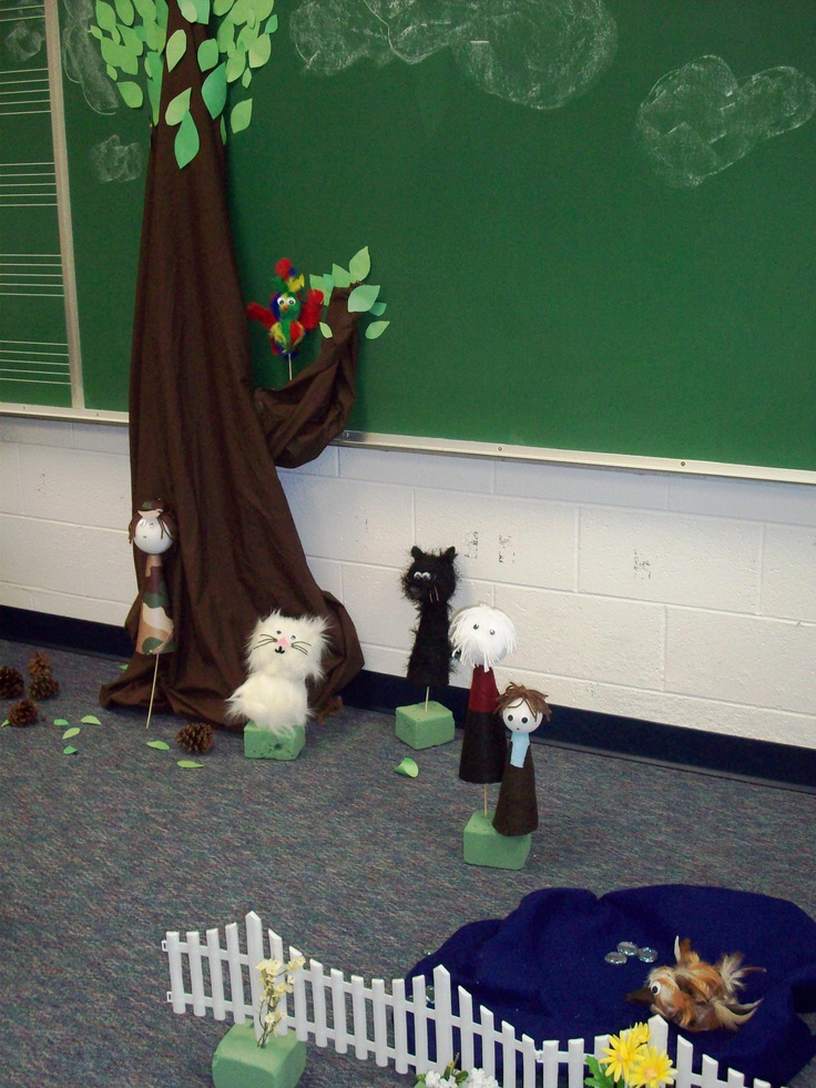 """The stage is set for Peter and the Wolf!   The tree is a brown sheet hanging from the top of the board, a pillow case """"branch"""", and green paper leaves. All puppets were made with a styrofoam base and various pieces of felt, crafting fur, or feathers."""