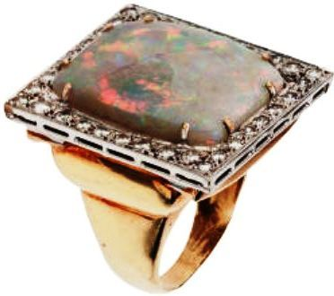 Elvis Presley's opal ring was one of his favorites. The 24 x 20 mm opal is surrounded by 34 full cut diamonds.  | ElvisBlog.net/.