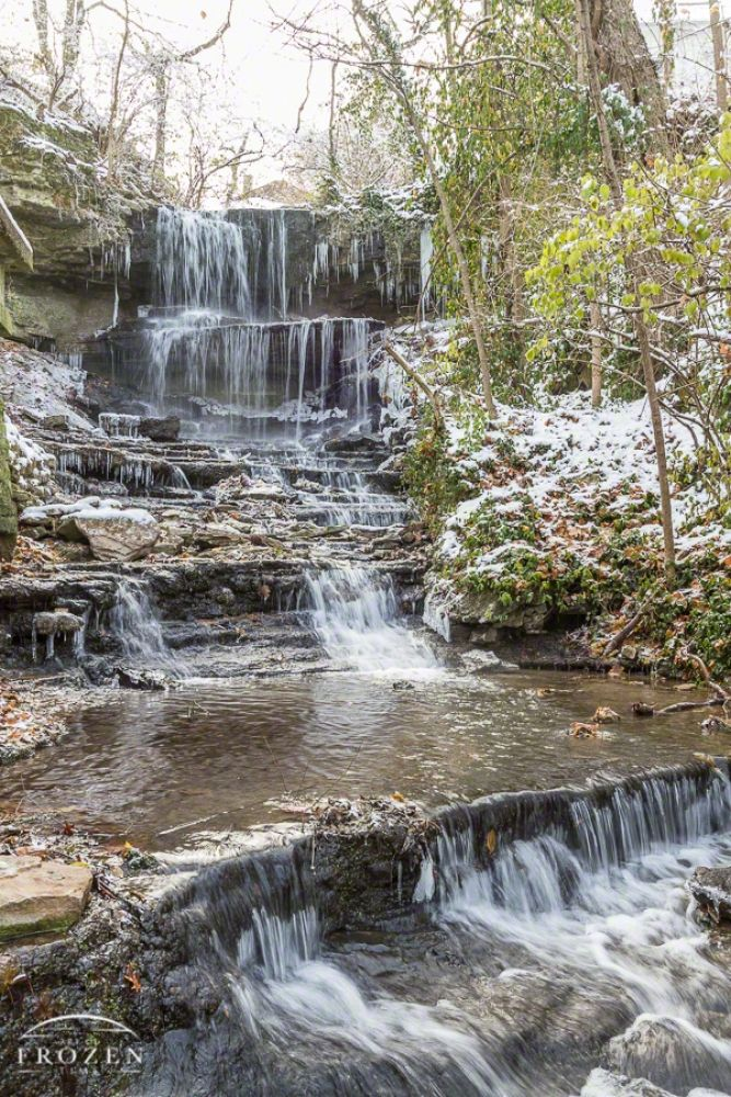 West Milton Ohio's Cascades - West Milton Ohio's Cascades provided a pleasant surprise due to the height and volume of the waterfall.  On this day, icicles hung from the waterfall as frigid temperatures settled over the area. #Astronomy #Geology #Ice #Landscape Photography #Meteorology #Miami Co. #Ohio #Photography #Scenic #Seasons #Snow #Sun #Sunset #United States #View #Vista #Waterfall #West Milton #West Milton Cascades #Winter