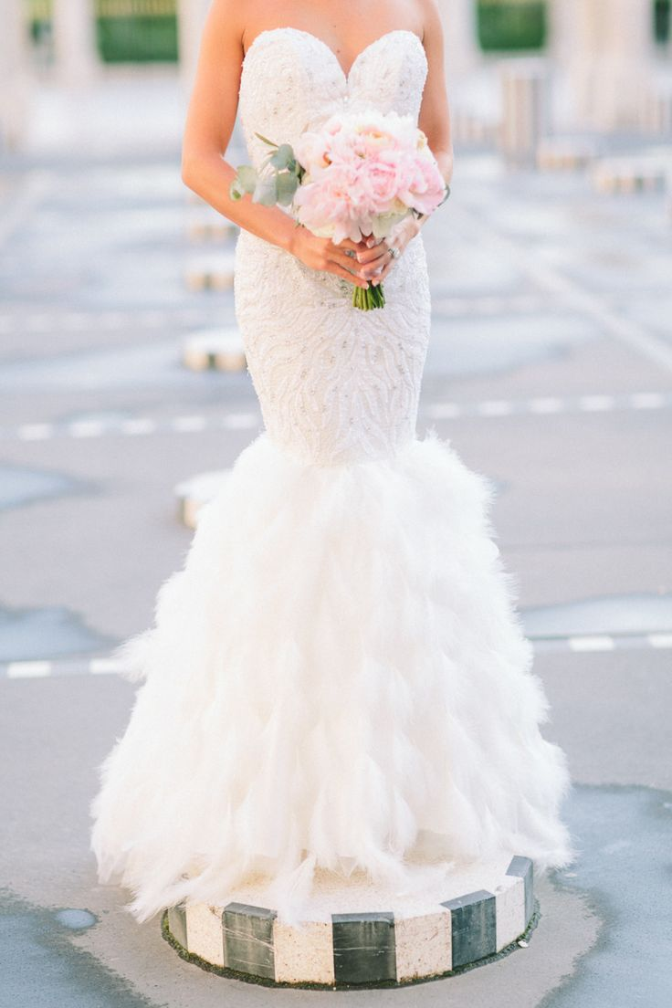 Wedding dress with feather skirt | Photography: French Grey Photography - www.frenchgreyphotography.com
