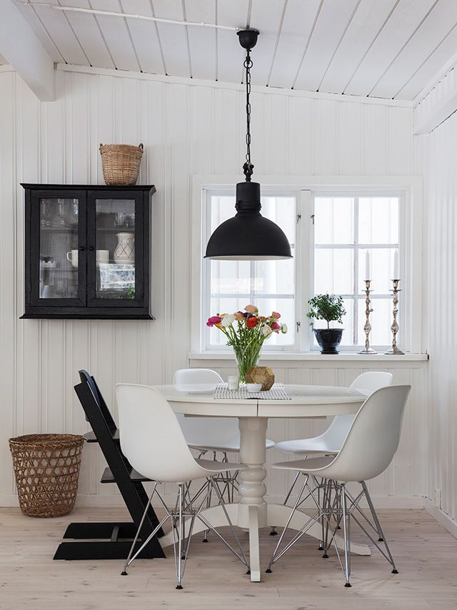 cottage meets mod in a black & white dining nook