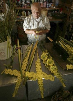 Here in the U.S., in Southern Californian Latino communities, the designs created with the fronds are spectacular. One such artisan, profiled in a recent article in the Los Angeles Times, is Esteban Torres who weaves the fronds into various geometric shapes, flowers and, of course, crosses. In the two weeks leading up to Palm Sunday, Torres, his niece and a couple employees bang out around 1,500 palm pieces from his tiny flower shop inside a Santa Ana strip mall. He sells his pieces for $5…