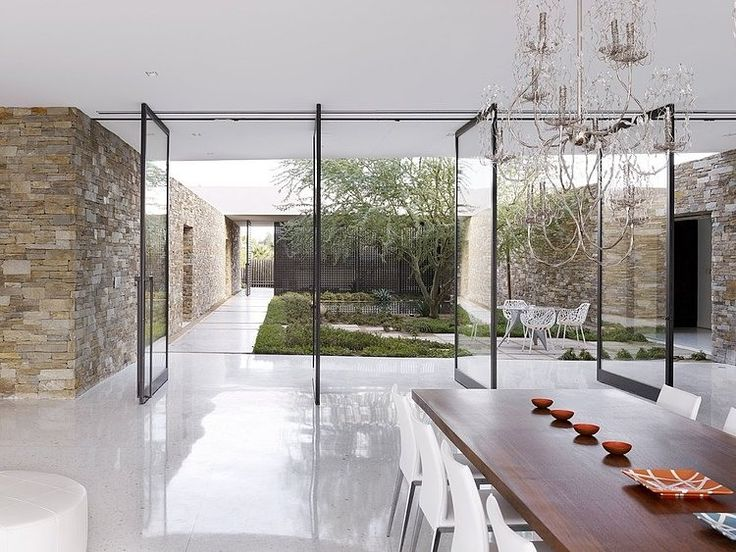 Madison Residence by XTEN Architecture - Those glass doors are amazing. Blurring the lines between interior and exterior space.