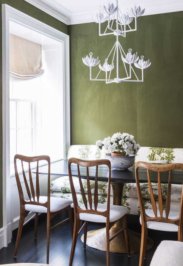 Interesting light fixtures in this dining room designed by Anna and Caroline Burke