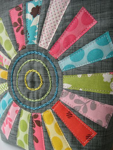 sunshine!! - instead of stitching in middle do a circle with raw edge? seems like it would be a cool applique over a dark quilt maybe in yellow shades on blue shades?