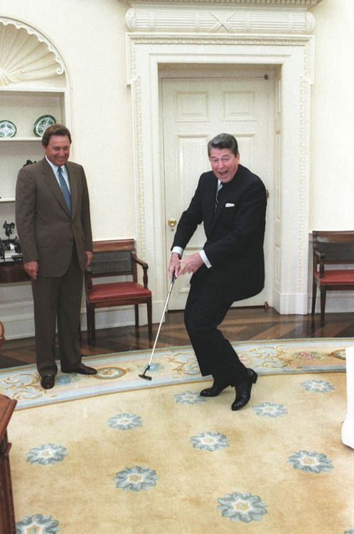 President Reagan (how cute is he?!) and golfer Raymond Floyd reacting after putting a golf ball in the Oval Office, 6/24/86.