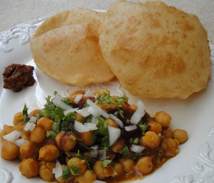 Originally a Punjabi dish, any mention of the Capital of India is incomplete without Chhole Bhature. Large fried breads made of Maida served with spicy chickpeas, in colloquial terms, is Chhole Bhature. The dish is way tastier than its name suggests. Chhole Bhature is ubiquitous in Delhi, and people who once have it, are sure to keep going back for more