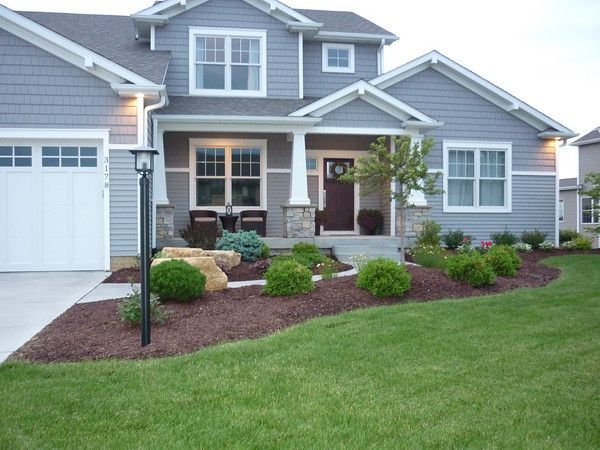 grey houses with white trim   The grey exterior and white trim offer a clean look while the mulched ...