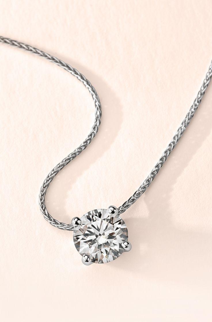 Signature Floating Diamond Solitaire Pendant In Platinum