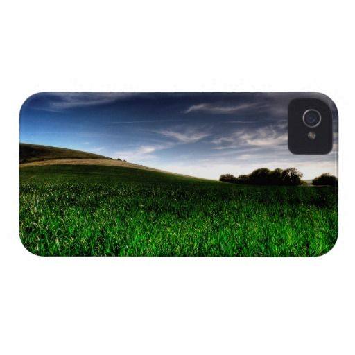 """Wilmington Fields :- Shot and captured near a large chalk figure known as the """"Long Man of Wilmington"""" in Wilmington village, Sussex, England. I loved the gentle curves and undulations, the clump of trees to the right and the wispy clouds. The lush green crop in the foreground helps give the image some depth and pulls you in. Cover For The iPhone 4. #iPhone4 #wilmington #sussex #england #fields #hills #rural #nature #scenery #landscape #meadows #crops #farmland #curve"""
