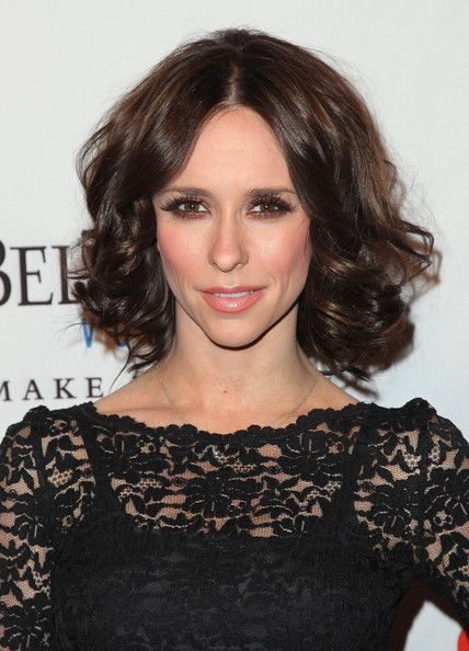 Messy Curls - Prom Hair Ideas - Jennifer Love Hewitt's flirty, medium-length style is a cinch to pull off: Just part your hair down the center and roll with curlers or a curling iron. A spritz of hairspray will keep it all in place.
