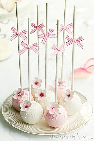 Dainty pink and white cake pops with bows on top #wedding #weddingdessert #desserttable #pink #white