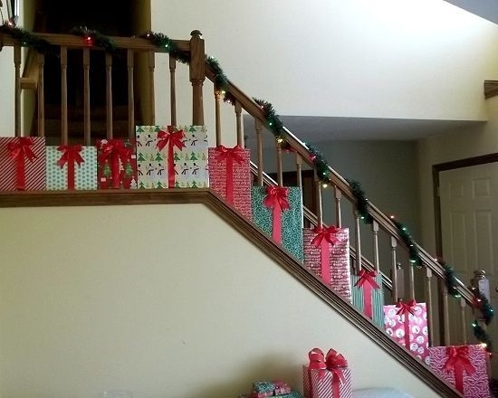 """To go with my PRESENTS Christmas theme this year, I came up with this decoration for my staircase. I love it and It will definitely make a statement with my other """"present"""" decorations. Here's how to make it."""