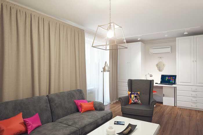Серый диван из IKEA в интерьере маленькой гостиной
