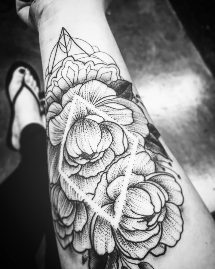 Stipplewhip geometric diamond negative space peony tattoo