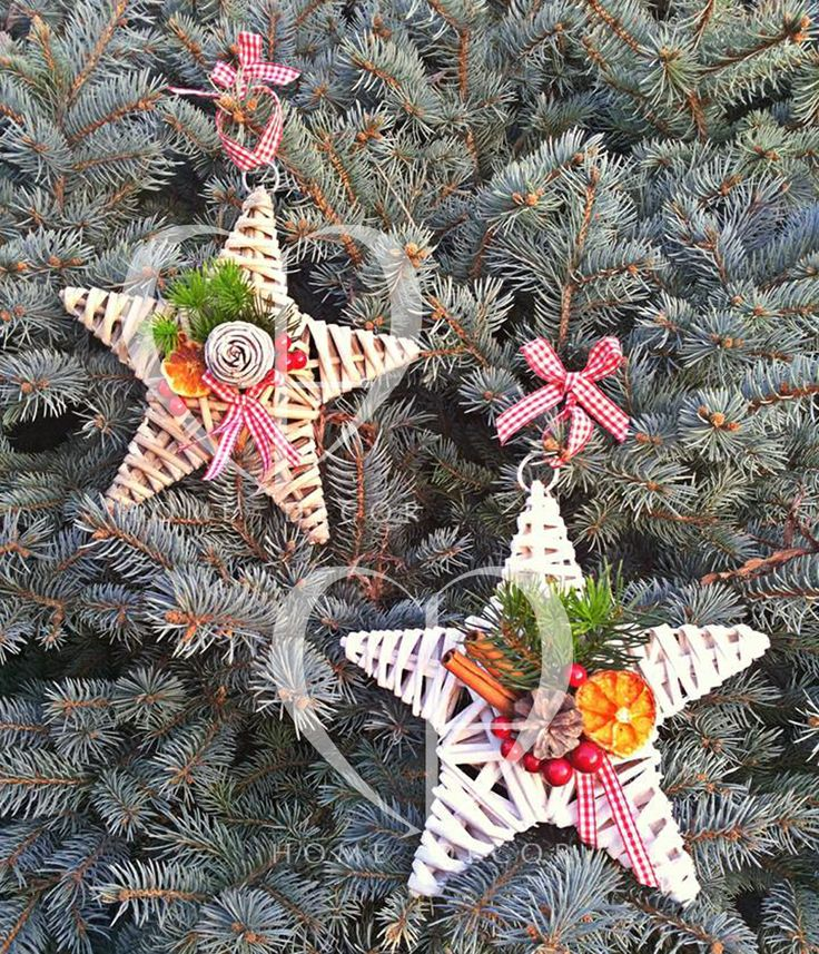 stars in white or natural rattan decorated with pine cones cinnamon sticks and dried slices of orange berries