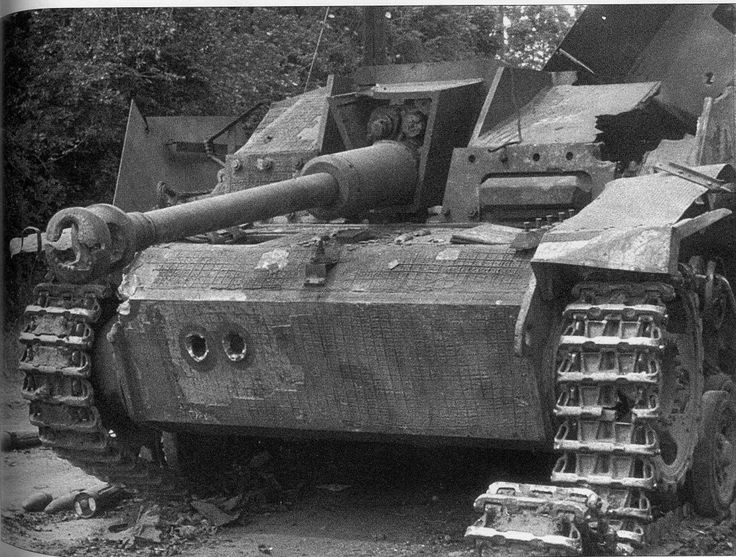 https://flic.kr/p/s9ZvLx | Stug III Ausf G, Pz.Jg.Abt 709, destroyed, Sainte-Mère L'église, France, 7 June 1944 | Destroyed StuG.III Ausf. G (Sd.Kfz. 142-1) Knocked out 300 meters north of the hotel Ville in Saint-Mere-Eglise by M4 tanks of Coy. C 746th Tank Battalion  supporting 82nd Airborne Division on D-Day+1. The Stug belong to the Pz.Jg.Abt.709/709 Infanterie Division. It has received a significant amount of hits blowing the roof off the superstructure  and the front of the mantlet…