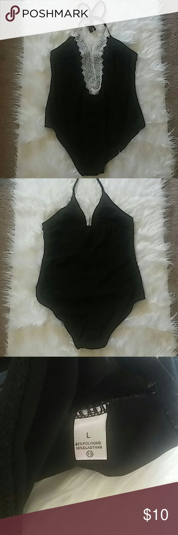 Women's one piece halter bathing suit This super cute never been worn one piece is flattering for all body types! The cute lace decorations give the swimsuit an extra touch. Swim One Pieces