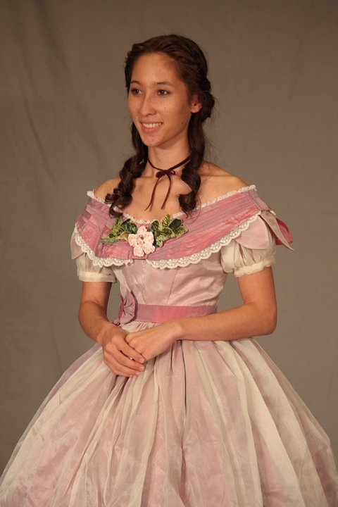 Another lovely ball gown with a sheer over skirt.
