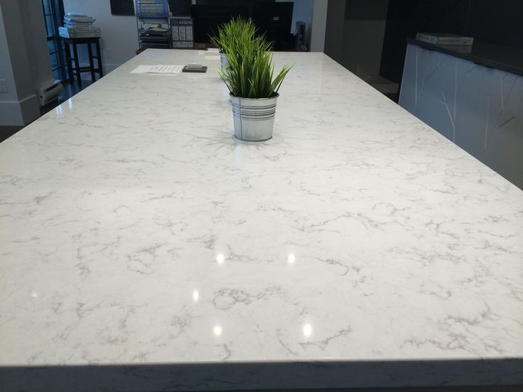 gray kitchen cabinets with minuet countertop
