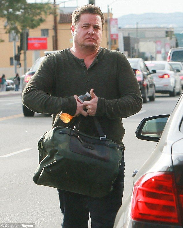 A whole new man: On Friday Chaz Bono - the son of iconic singer Cher - showed off impressive biceps and a built up torso