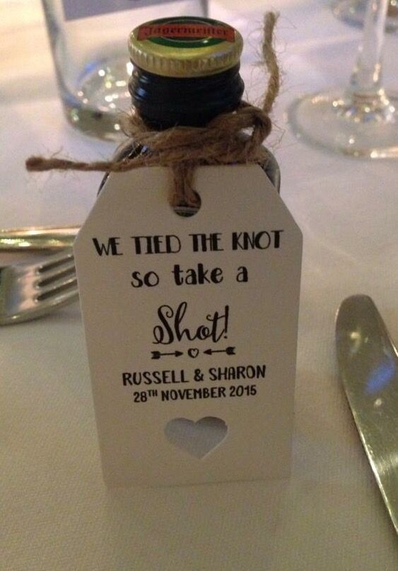 shot bottles for wedding favours. Great idea got everyone going! Personalised tags bought from eBay.