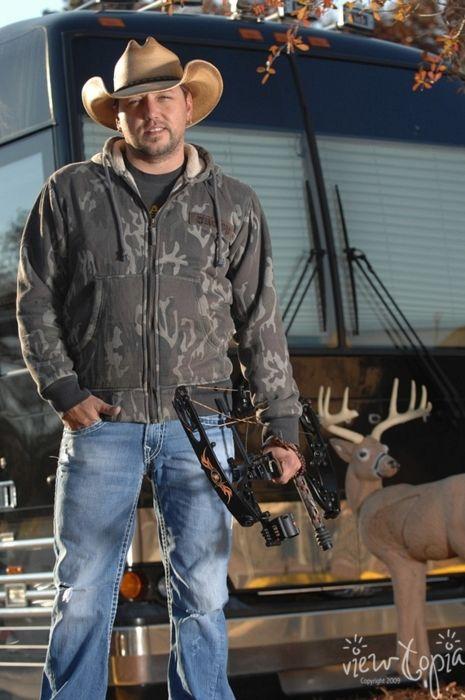 Jason Aldean - Cowboy hat, check. Camo hoodie, check. Jeans, check. Precision bow, check. RV, check. Tacky ass fake deer lawn ornament (!), check. Jason Aldean = hot bubba??? DOUBLE CHECK!
