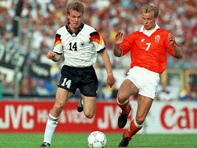 Holland 3 Germany 1 in 1992 in Gothenburg. Thomas Helmer runs the ball passed Dennis Bergkamp in Group B at Euro '92.