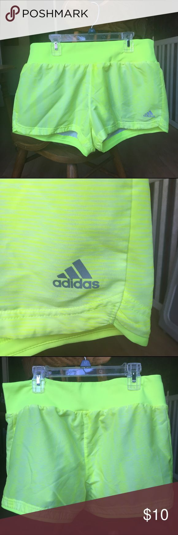 Adidas running shorts Neon yellow running shorts. A little see through, work perfect with spandex underneath Adidas Shorts
