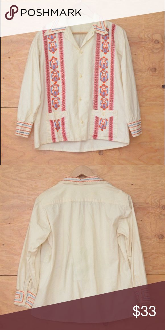 Vintage 70's Mexican Ethnic Embroidered Top SZ M DESIGN DETAILS INCLUDE: Just in time for summer Festivals and evening drinks by the bone fire. This beautiful vintage 70's button up blouse has lot's of flare and style. White shirt, floral embroidered detail at chest in pastel pink, blue, and orange. Long sleeves, great hipster / hippie / western look, pointed collar.   CONDITION: EXCELLENT~ Previously worn, with only very slight wash wear; no flaw Tops Button Down Shirts