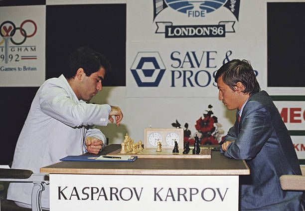 Gary Kasparov and Anatoly Karpov of the Soviet Union on 2 August 1986 during the Save Prosper Centenary World Chess Championship in the Park Lane...