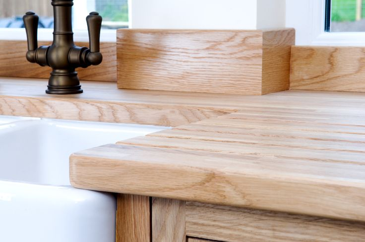 Wood meets wood in this traditional kitchen with a solid Oak worktop and traditional framed cabinetry.