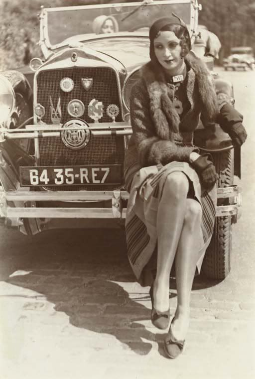 1920's flapper. France. Given the era, that sheen you see on her legs is probably silk stockings.