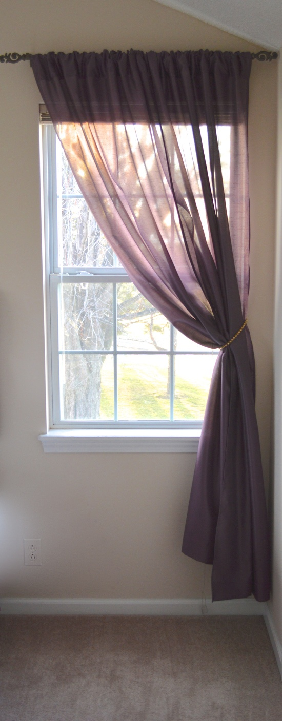 the single window with two sheer curtain panels on a. Black Bedroom Furniture Sets. Home Design Ideas