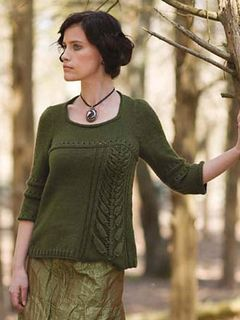 Pullover with wide u-neckline includes wheat tassel insert, yoke, and elbow-length sleeves with eyelet and reverse stockinette ridges.