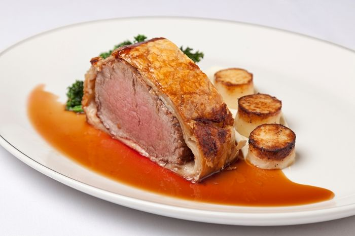 Fillet of beef wellington with parsley root purée mini fondants, sautéed kale and rosemary jus