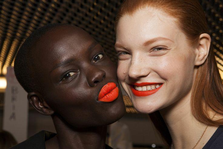 Get ready for the matte orange lip trend.