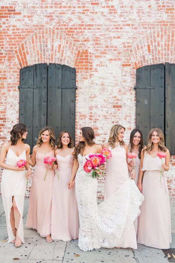 lace wedding dress with pink bridesmaid dresses - photo by Valorie Darling Photography http://ruffledblog.com/floral-filled-carondelet-house-wedding/