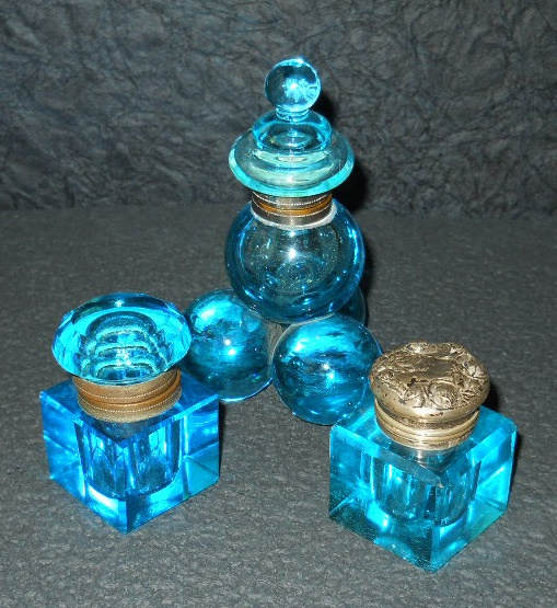 Three brilliant blue inkwells. The ball pyramid crystal one was made in France while the one on the lower right has a sterling silver lid made by Foster & Baily._Judith Walker's Collection