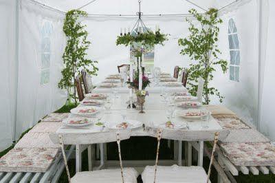 Klassisk midsommardukning i partytältet, Swedish midsummer. Table setting