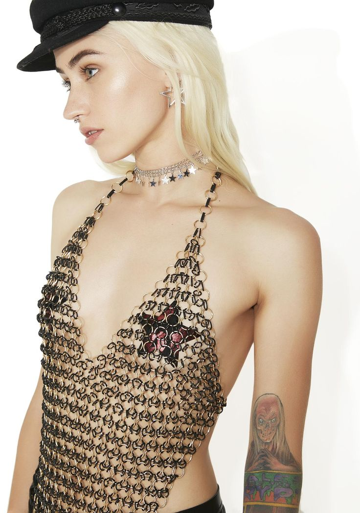 Warrior Woman Chain Top bringin' some justice to the streets...Join the rest of the Amazons in this sikk top featuring an interlocking design constructed from metal O-rings and rubber rings, scooped neckline, pointed hem and adjustable clasp closures at the neck and back.