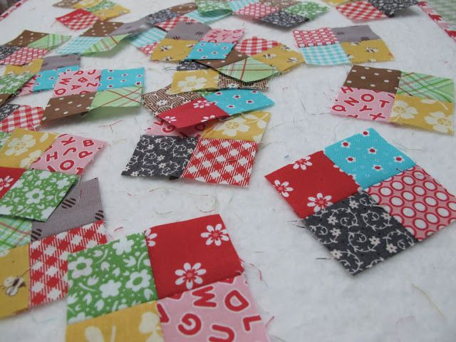 An incredibly clever way to make tiny one inch four patches....very fast and efficient!