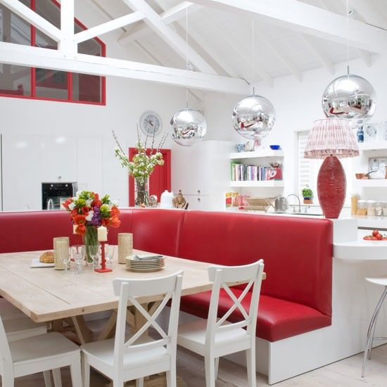 Red and white kitchen-diner. Not exactly my style but I think its cool!!!
