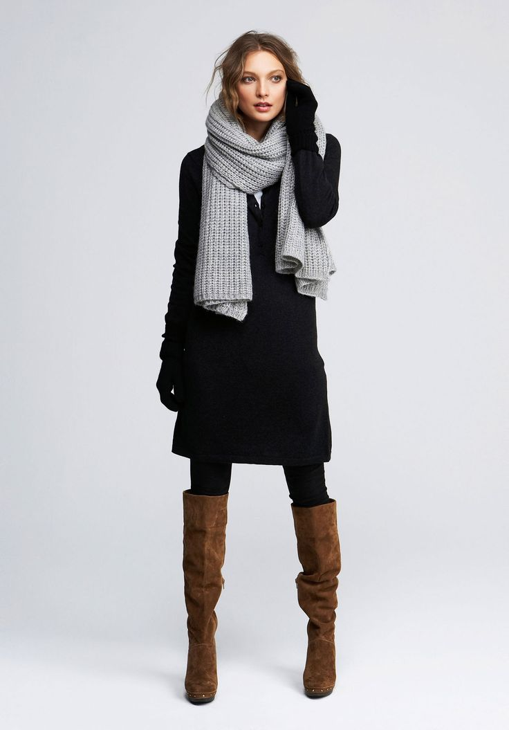 Fall winter style. Grey scarf . Black coat. Brown boots.