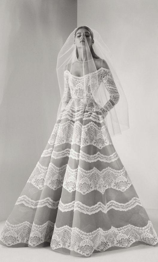 Uniquely elegant long-sleeve off-the-shoulder lace detail wedding dress; Featured Dress: Elie Saab