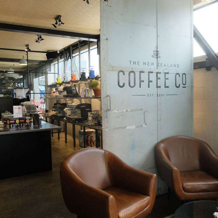 The New Zealand Coffee Co flagship Café, Newmarket. Base units in high gloss black TG&V panelling to the Shop front with carrara marble worktop, Also base units for the cupping room and machine showroom.