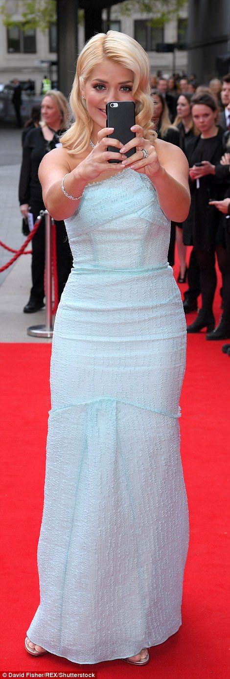 The former I'm A Celebrity winner stepped out looking sensational in a star-themed mini-dress that perfectly highlighted her slender frame as she arrived on the red carpet for this year's BAFTAs.